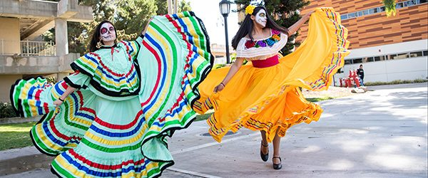Hundreds of students, faculty, and staff celebrated Dia De Los Muertos at the Student Services Center North patio on November 1, 2018. The exciting event, hosted by Puente and Intercultural Programs (ICP), featured a day of cultural learning, dance and music, crafts, food and festivities.